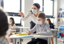 teacher and students with face masks in class