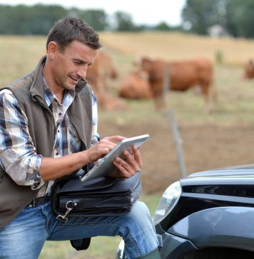 farmer with mobile tablet
