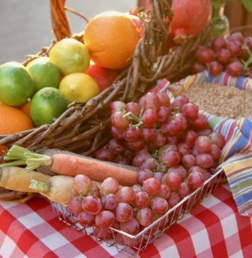 grapes carrots and citrus on picnic table