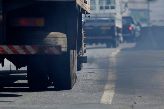 Toxic pollution is emitted from a truck exhaust pipe