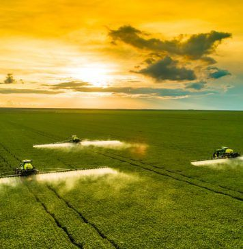 field being sprayed with pesticides