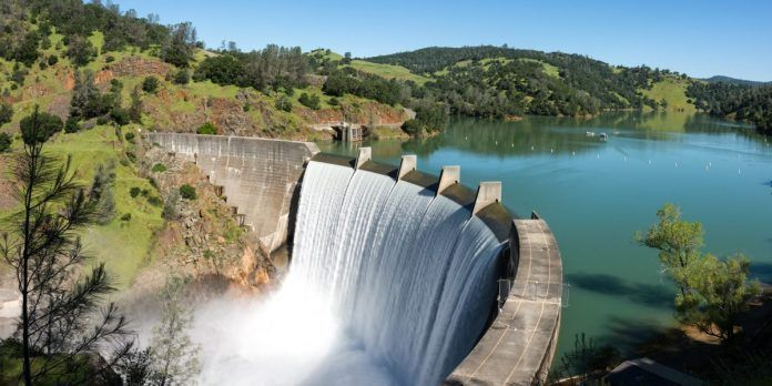 Water spills over the top of Englebright Dam on the Yuba River