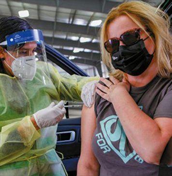 woman receives a COVID-19 vaccine shot