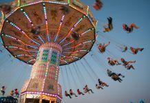 fairgoers on a carousel