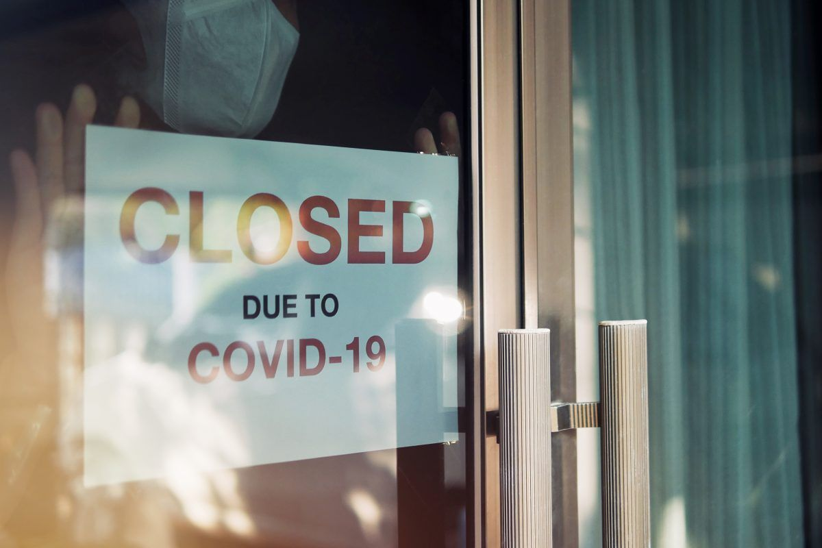 business door with covid sign